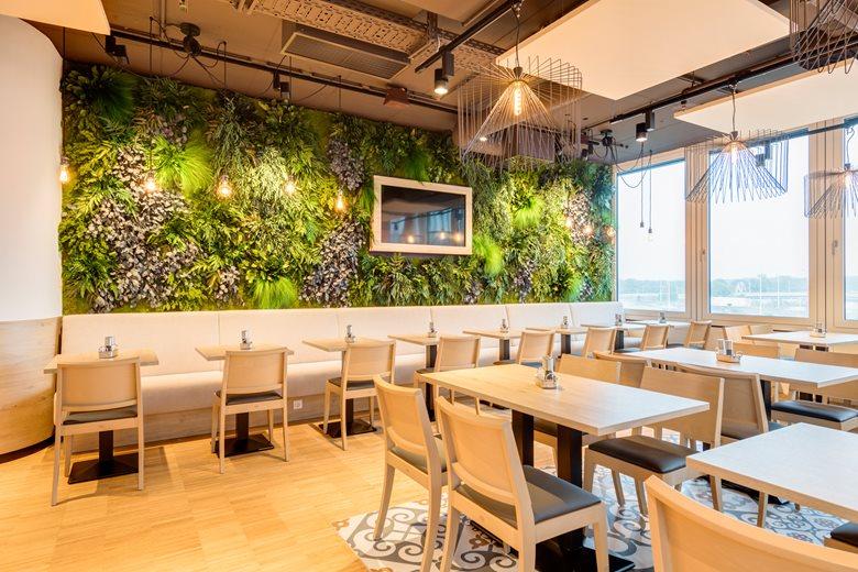 Vertical garden in jungle style inside office space