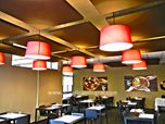 Absorbent treatment with acoustic panels for a restaurant.