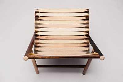 Old handles of brooms turned into chair by Reinier de Jong