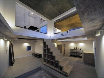 House T: life passes-by through large rectangular holes