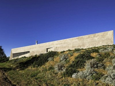 Residence in Sykamino: a pointed shell amongst the Greek olive groves