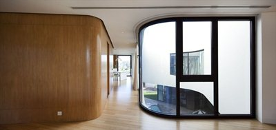 Fluidity and rigour in Agi Architects' Mop House