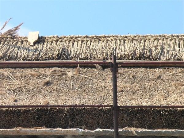 Restauro bioarchitettura bioedilizia  con tetto in paglia intonaci terra cruda ferdinando forlati